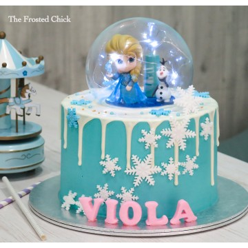 Frozen Elsa & Olaf Inspired Globe Drip Cake