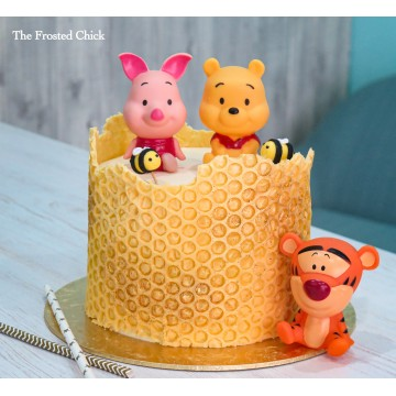 Honeycomb Cake with Winnie the Pooh and Friends toppers